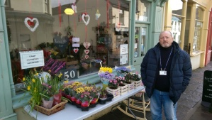 Councillor Alan Jones outside Flowers by Stacey